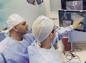 Surgeons Looking at Images During Spine Surgery